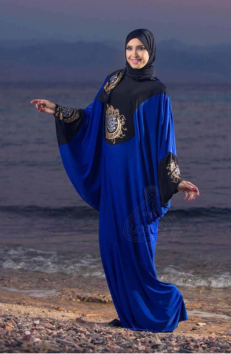 Butterfly Abaya Blue with Black Trim and calligraphy printed on bust  Very wonderful Butterfly Abaya. It'made of Fezon mixed cotton. Abaya has a red Trim and printed arabic calligraphy on Bust with a scarf from the same material and with the same printed décor to give it the cultural touch.