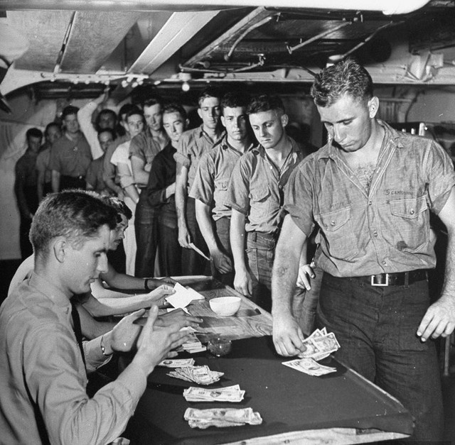 1942 - Payday on a Navy cruiser. Sailors were paid like this until about 1988 when ATMs were introduced on ships.