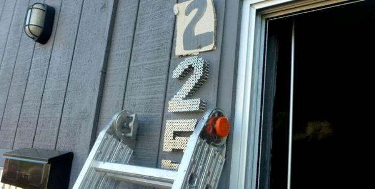 DIY house number sign using industrial looking screws