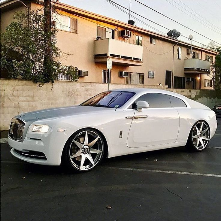 (Rolls Royce Wraith) -I'm sorry, not a Rolls Royce fan, but this one is really bad - ass