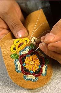 it takes talent to freehand floral beadwork without paper drawn patterns underneath - beads straight onto the moosehide - nice!