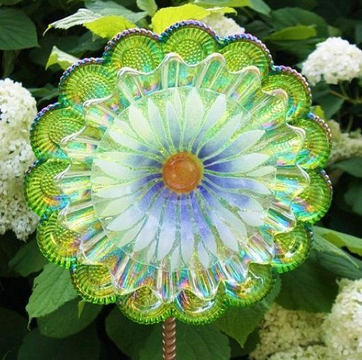 Garden flower suncatcher made from miscellaneous thrift store clear dishes. Scalloped edge plates used.