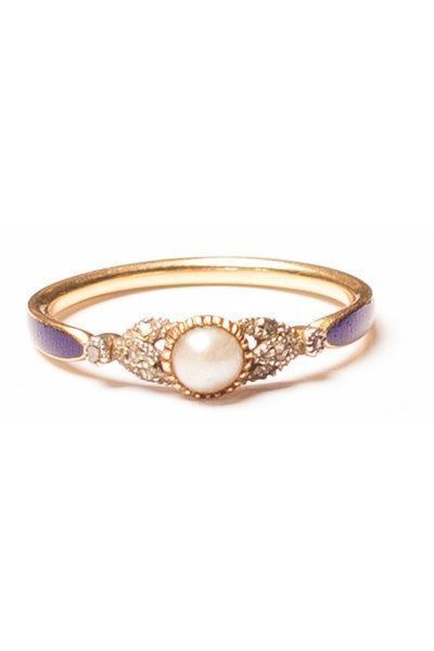 Pearl engagement rings are often antique finds, so if you appreciate the romance of history, keep an eye out for a stunning vintage rings like this one.