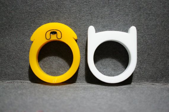 A pair of laser cut acrylic rings based on Adventure Times Finn Hat and Jake the Dog himself. This is a combo pack, both rings will be delivered in