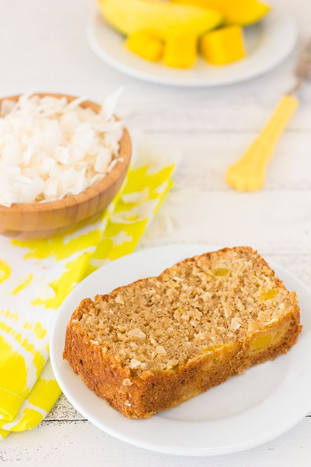 Coconut Mango Bread - a moist and tender, tropically-inspired loaf flaked with coconut and juicy mango bits.