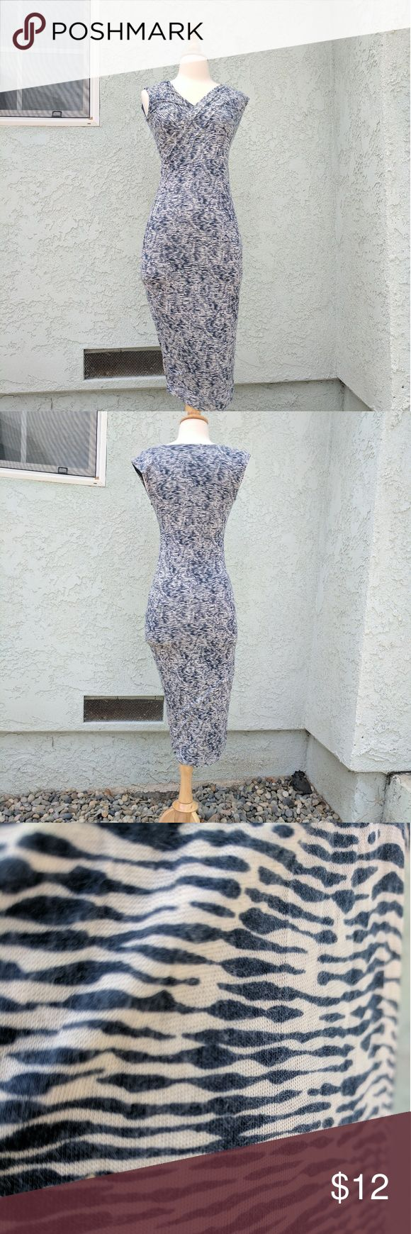 SALE Blue animal print bodycon v-neck dress XS Blue & white bodycon dress, lots of stretch in it. The blue tone is like denim that has been comfortably worn in. Light pilling as in the close-up. 100% modal. From a smoke-free cat-free home. Kenneth Cole Dresses Midi