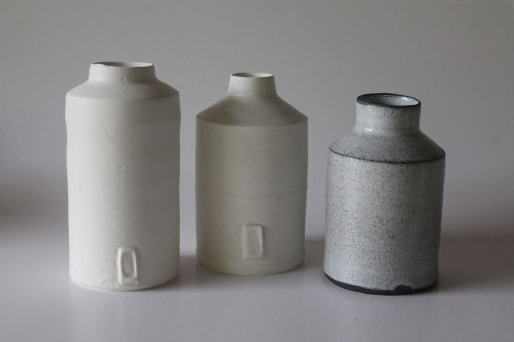 Louise Jennings, porcelain and black stoneware cylinders