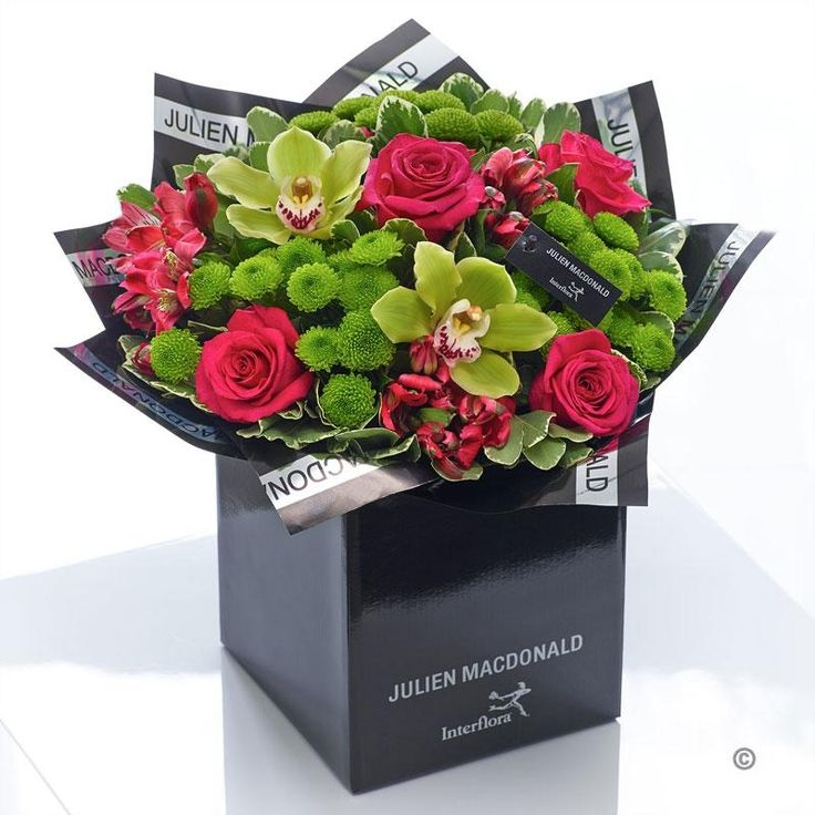 This ultra-stylish design in vibrant lime and cerise is real showstopper. We've chosen distinctive mini orchids in an exotic shade of green and partnered them with classically beautiful roses and delicately textured tiny chrysanthemums. It's an impressive gift that is rich in colour and detail.