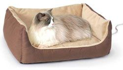 Thermo-Kitty Cuddle Cushion - Heated Cat Bed. I need this for my dog!