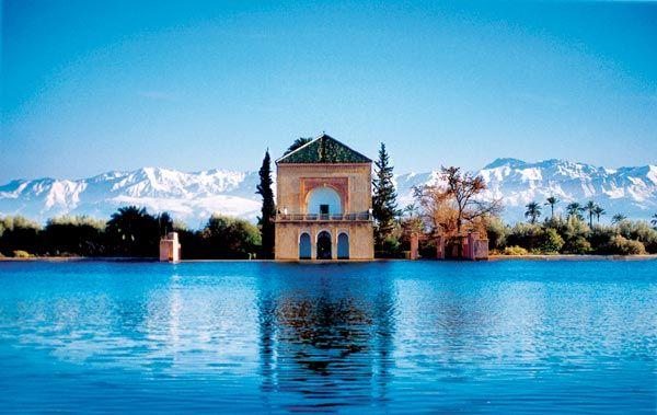 Atlas Mountain behind Menara Gardens Marrakech, Kingdom of Morrocco - Northern region of Africa