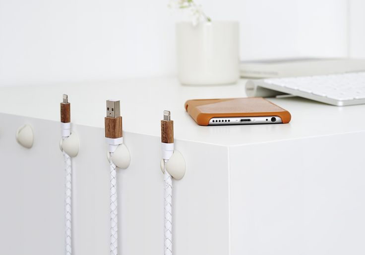 Deconstructing the Nordic Workspace: Tidy up electrical wires around your desk for a more uniform appearance. Try to think vertically as well as horizontally, attaching cords to the side of your desk means that they're on hand without creating a mess. Read more at: http://www.lumene.com/us/content/deconstructing-nordic-workspace