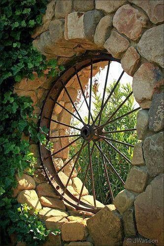 Wagon wheel for window in guests shower