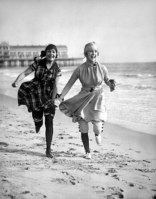 1910 Beachwear This picture presents us the freedom that women had achieved in the late 1910s. They are wearing shorter dresses, without corset, running on the beach and having fun. There are no boundary, no circumstance, or judgement.