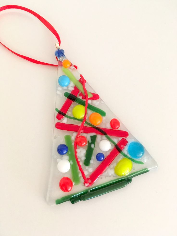 For your tree or as a gift for a special friend this hand-made one of a kind ornament will make you smile! Each small transparent tree is embellished with assorted colored balls, stringers and white c