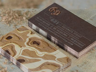 Business Cards by Mackey Saturday. Their duplexed wood veneer + letterpressed metallic ink on paper with laser etching on both sides. #dribbble