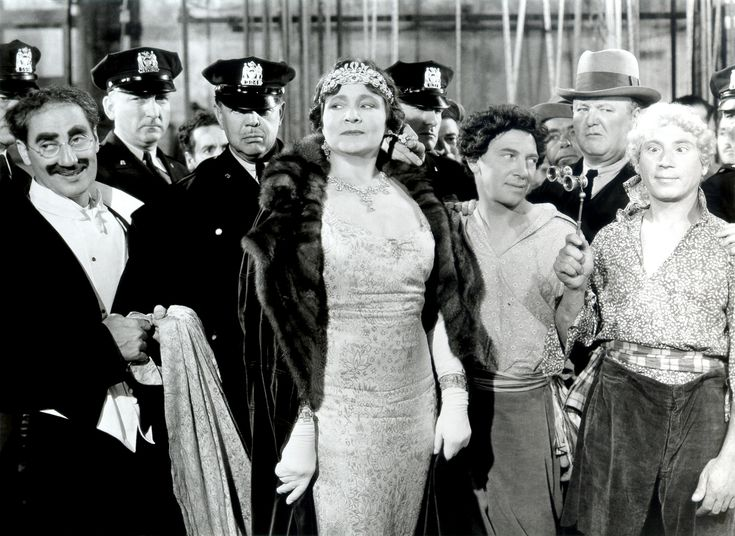 Margaret Dumont and the Marx Brothers -- A Night At The Opera.