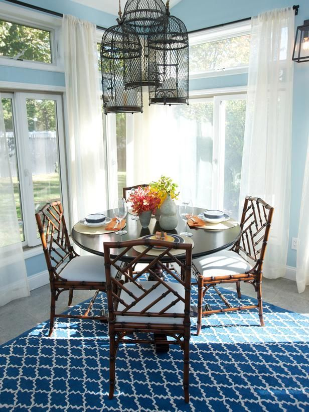 Beautiful light and blue breakfast nook. Like the bird cages, neat idea for lights.