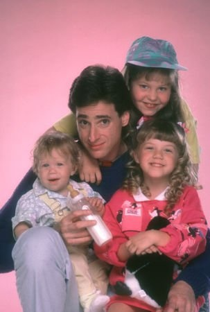 Full House.. Loved it!! With dad Danny Tanner (Bob Saget) and three daughters Michelle (played by the twins Mary-Kate  and Ashley Olsen), Stephanie (Jodie Sweetin) and D.J. (Candace Cameron Bure) Aired from 1987-1995.