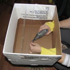 To prevent dust and small particles from escaping into the room when you're sanding fine items, try building a simple dust containment box. Basically you need a cardboard box, some old rubber gloves, a few layers of saran wrap, and tape. [Via Pinterest]