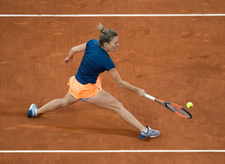 Simona Halep Photos - Simona Halep of Romania in action against Kristina Mladenovic of France in their final match during day eight of the Mutua Madrid Open tennis at La Caja Magica on May 13, 2017 in Madrid, Spain. - Mutua Madrid Open - Day Eight