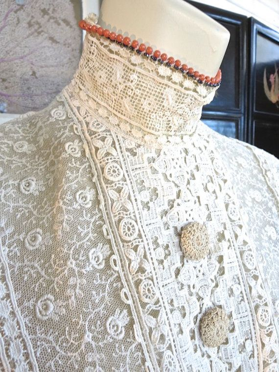 Close up of lace details on this antique 1900's Lace Edwardian Blouse. Beautiful lace insertions, collar, beads, buttons.