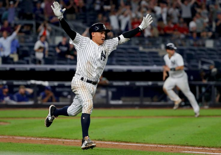 New York Yankees' Ronald Torreyes gestures as he runs to first on the game-winning RBI single to center field against the Texas Rangers during the 10th inning of a baseball game, Friday, June 23, 2017, in New York. The Yankees won 2-1. Gary Sanchez scored from third base. (AP Photo/Julie Jacobson)