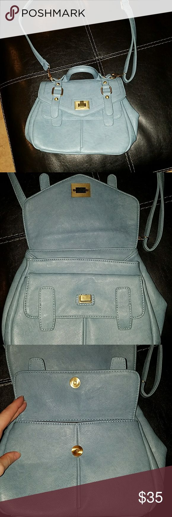 Light blue satchel/crossbody purse Very cute light blue satchel purse. I do not know the brand but I bought this in Hong Kong at the Victoria Falls Mall. Has a front and back compartment and then two compartments in the middle with 2 zipper spaces and sleeve spaces. Attachable long strap as well. Bags Satchels