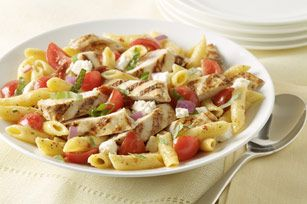 Bistro Chicken Pasta Salad recipe - Full of Mediterranean flavors from the feta, fresh tomatoes and basil, this dish rivals the grilled chicken pasta salad at your favorite restaurant.