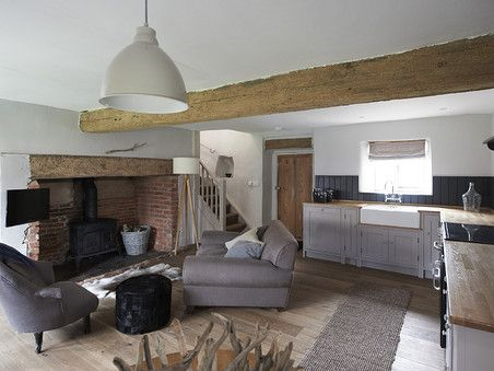 grey accents against crisp white walls and contemporary cottage interior cartshed cottages sharrington hall - Modern Cottage Style Interior Design