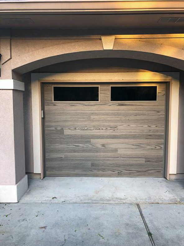 Driftwood Planks Garage Door By C H I Overhead Doors Garage Door Design Garage Doors Garage Door Windows