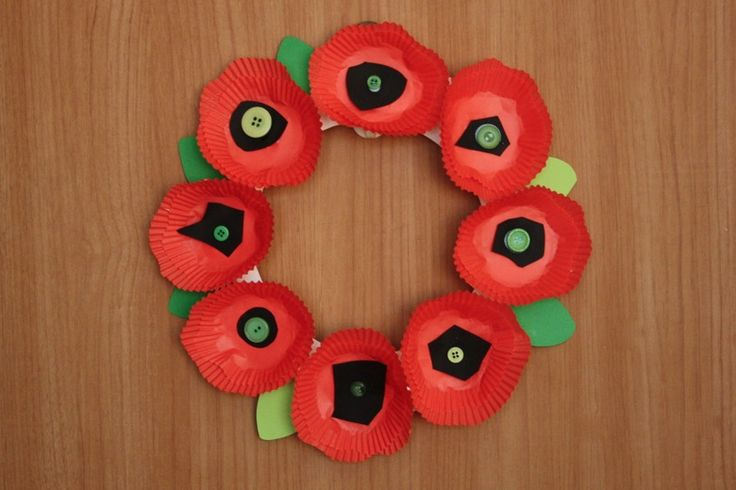 After taking down our Halloween footprint bunting during our major clean-up today, Gracen and I decided we needed something new on our apartment door – something to help celebrate Remembrance Day.  After searching around the web for a few minutes, we found this beautiful poppy wreath craft kit and decided we could make our own…