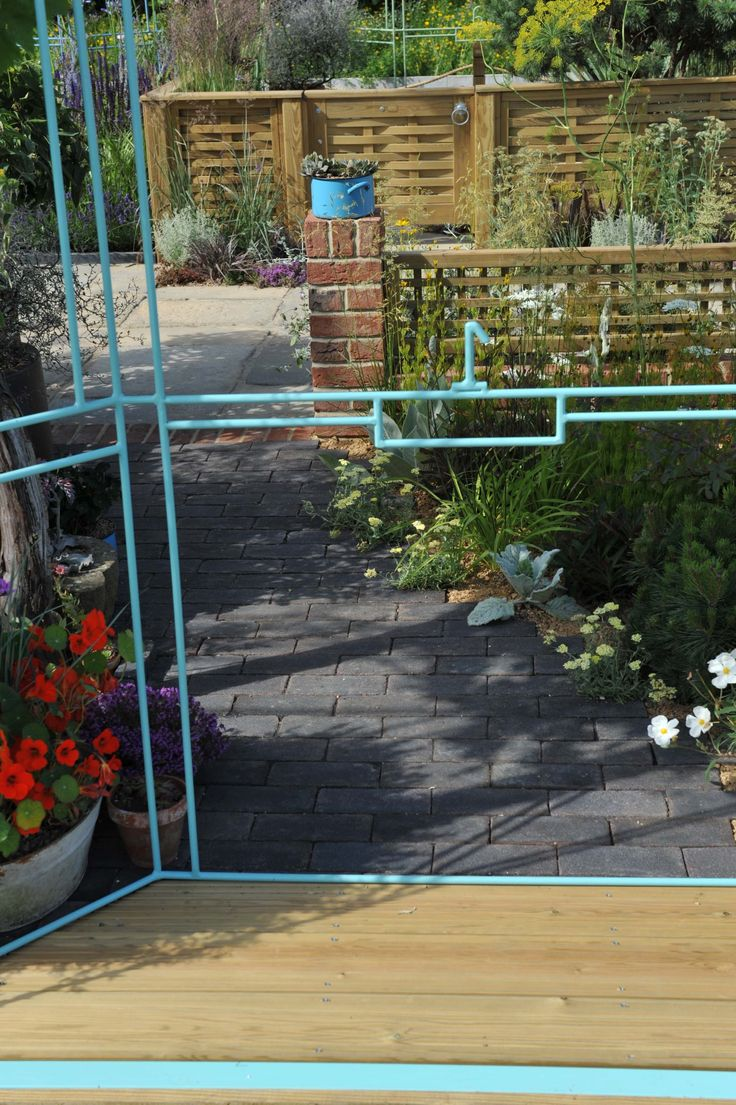 garden one detailed shot shows a wonderfull brick pathway and a traditional brick wall with - Brick Garden 2015