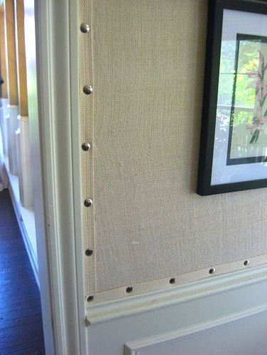 instead of removing all the old wallpaper from a MH wall, consider this.....  staple fabric, then using upholstery nails and trims.... :-)