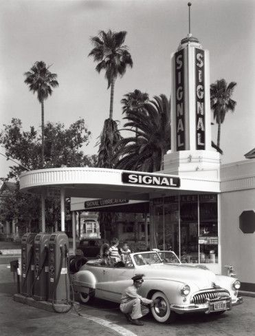 Gas Station, c.1950 - aaaaah yes....those were the days!!! You just sat in your car and the nice attendant did all the work....not only pumped your gas, but checked your oil, and cleaned your windows....dirty or not!! And if you asked...they would check your air pressure and put the air in your tires too if needed. Can you imagine....those were the days my friend...