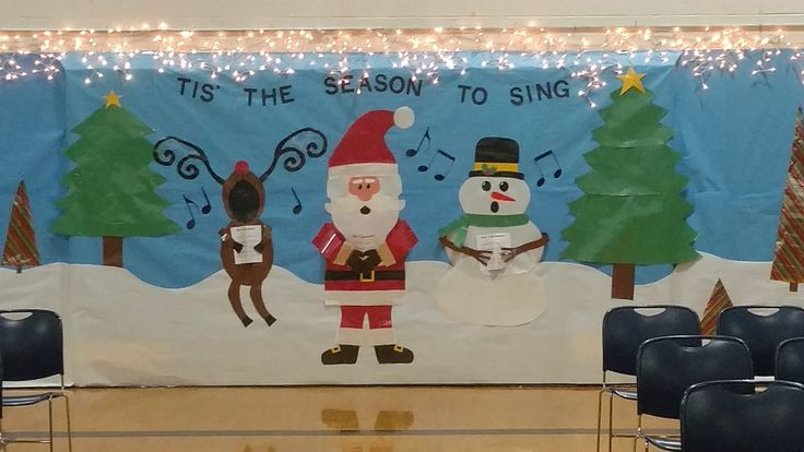 Elementary Christmas Concert wall decoration. My first one! Tips: use double stick tape to hold paper cutouts in place while laminating; laminate your characters in sections for easier hanging & future reuse; use packaging tape.