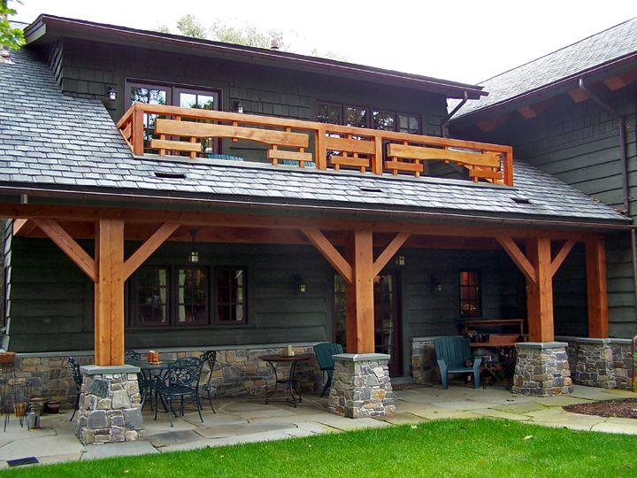 A Traditional Timber Frame Porch Is Topped With A Balcony