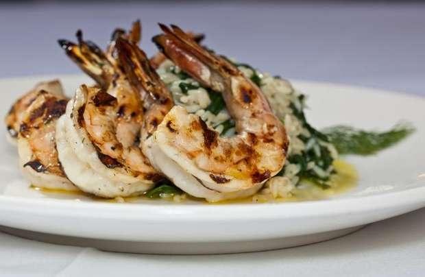 Grilled shrimp over spanakorizo at Nemea Greek restaurant in Mamaroneck