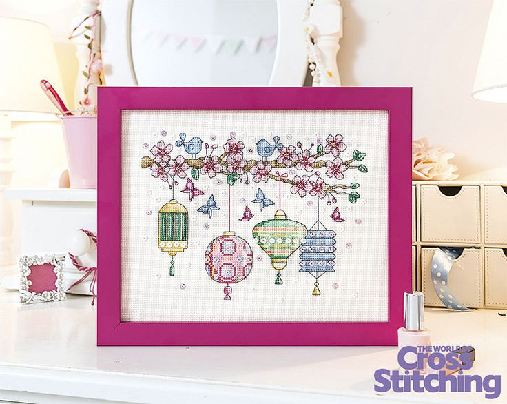Sparkle and shine - #Chinese #lanterns cross stitch. Light up your life with this Eastern-inspired design, complete with beautiful cherry #blossoms and pretty bluebirds. Add #sequins for a feminine touch too! Enjoy this project idea only in issue 226 of The World of Cross Stitching magazine