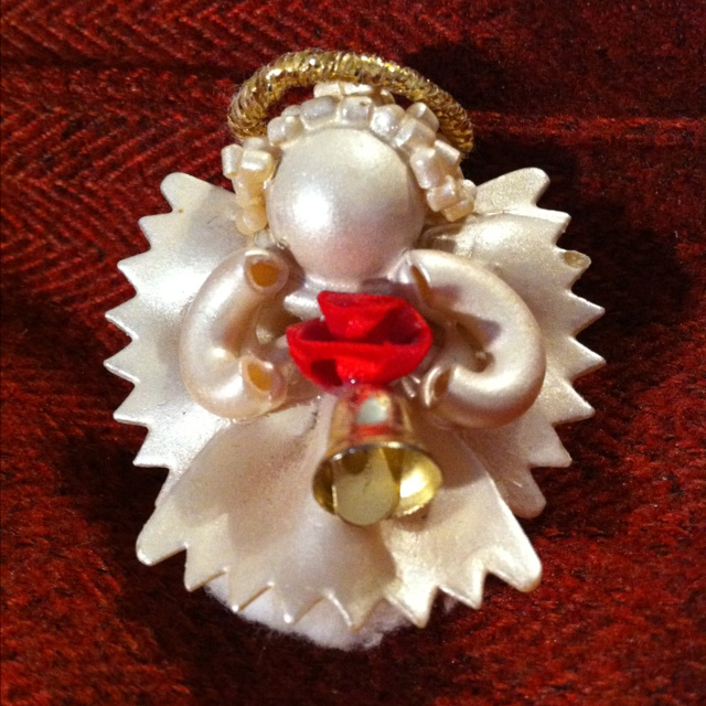 Pasta Angel - bowtie for wings & skirt, macaroni for arms, antipasti for hair, wooden ball for head. Spray paint white or opal. Can glue a pin on back to pin on coat or sweater.