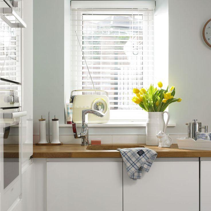 Modern white kitchen with retro radio