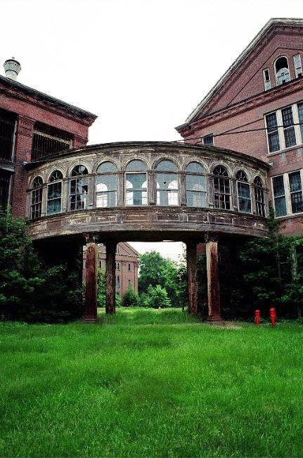 Taunton State Hospital built in 1854 in Taunton, Mass. Built according to the Kirkbride plan of mental asylums. The breezeways were added in the 1890's to connect the neo-classical buildings. After abandonment, most of the buildings burned down. The rest were demolished in 2009.