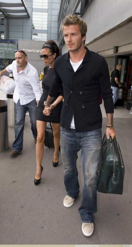 David Beckham does casual travel wear well.   And double-breasted jackets (and sweaters) appear to be making a comeback.  Love this with the canvas sneakers and distressed jeans.