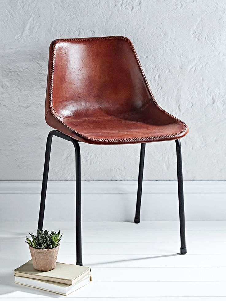 Our industrial inspired chair has strong black iron legs and a plastic moulded seat that has been carefully clad in quality brown leather. With a wide base and curved back, this unique and versatile chair is ideal for your desk or sat around your dining table.