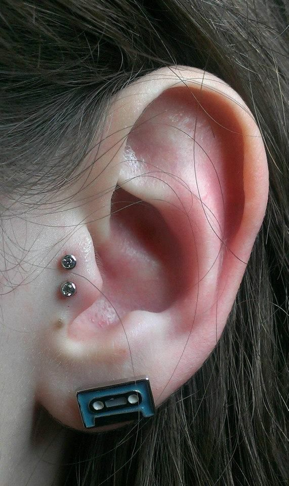 Double tragus piercing done by Miss Mandi at Crimson Heart Designs Studio 2, Rice Lake, WI