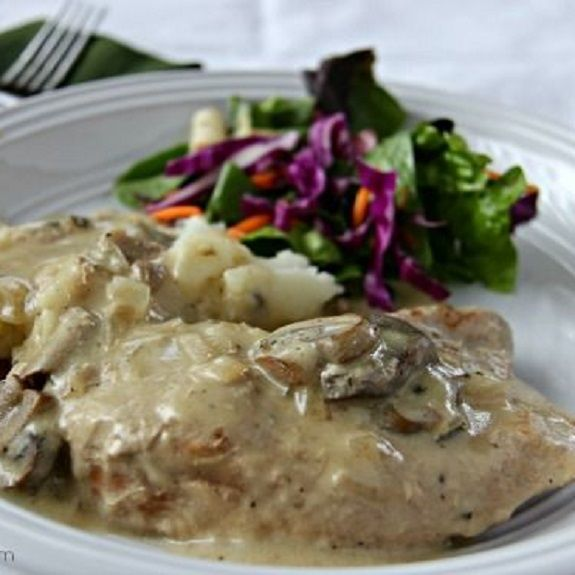 Slow cooker pork chops with mushroom-wine sauce.Pork chops with vegetables and white wine cooked in slow cooker.Very easy and delicious!
