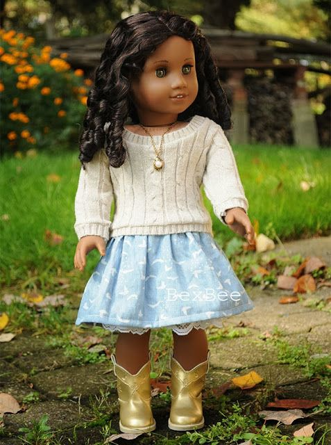 18 Inch Stitch: Latest American Girl Doll Addition! Cecile. (blue birds in flight dress layered under cream colored, scoop neck, cable knit sweater)