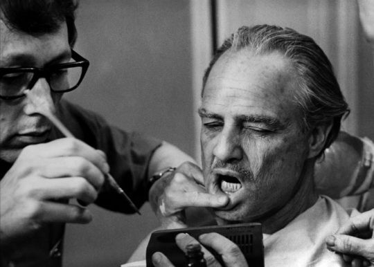 "Dick Smith applies makeup to Marlon Brando for his performance as Don Vito Corleone in ""The Godfather"" (1972)."