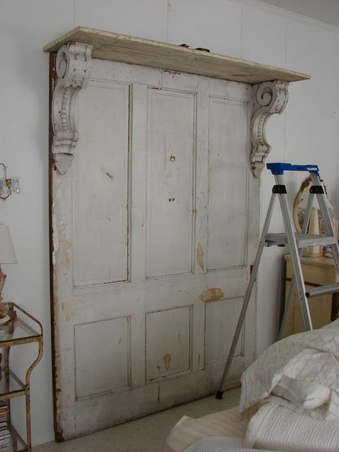 Old doors and corbels with shelf...great also used for headboard in bedroom!!!