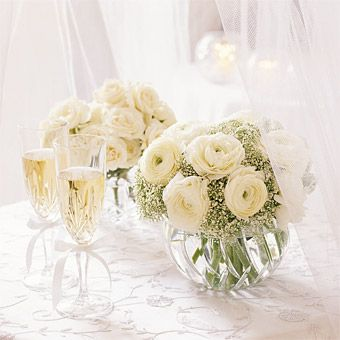 Brides.com: White Winter Wedding Flower Ideas. Soft and white, this simple arrangement of white ranunculus and gypsophila sits in a cut crystal bowl. Karen Bussen  From SIMPLE STUNNING WEDDING FLOWERS by Karen Bussen. Reprinted by permission of Stewart, Tabori & Chang.