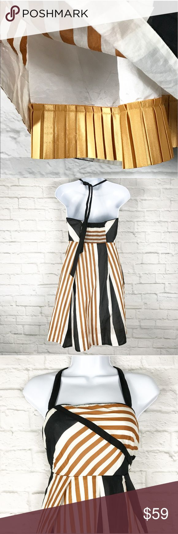"""ANTHROPOLOGIE Edges Angles dress Moulinette Soeurs Moulinette Soeurs Anthropologie Edges & Angles Dress Size 0  100% Cotton with 100% Acetate lining Black, White, and Bronze angled stripes Halter strap ties around neck Side zip Smocked back Lining has pleated gold hem  Retail $148  Perfect  Measurements, laying flat:  Bust, along top hem: 14.5"""" Waist, along seam: 13.5"""" Length (top underarm seam to bottom hem): 27"""" Anthropologie Dresses"""